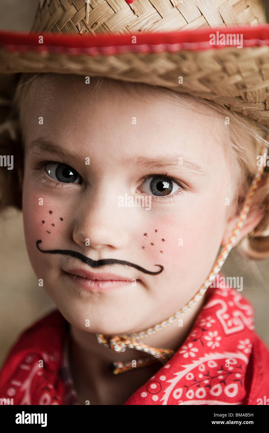 Young girl dressed up as cowgirl - Stock Image