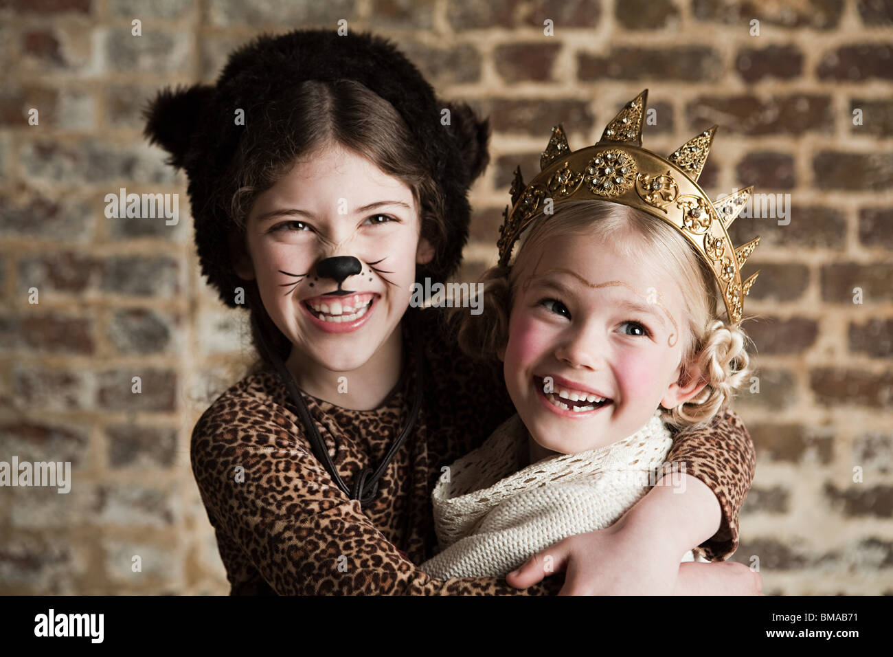 Young girls dressed up as cat and queen Stock Photo