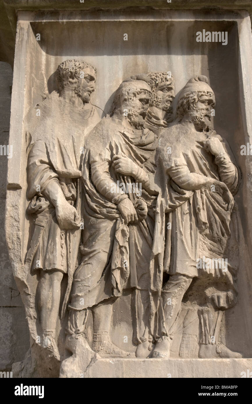Rome, Italy.  Bas-relief showing Parthian prisoners. - Stock Image