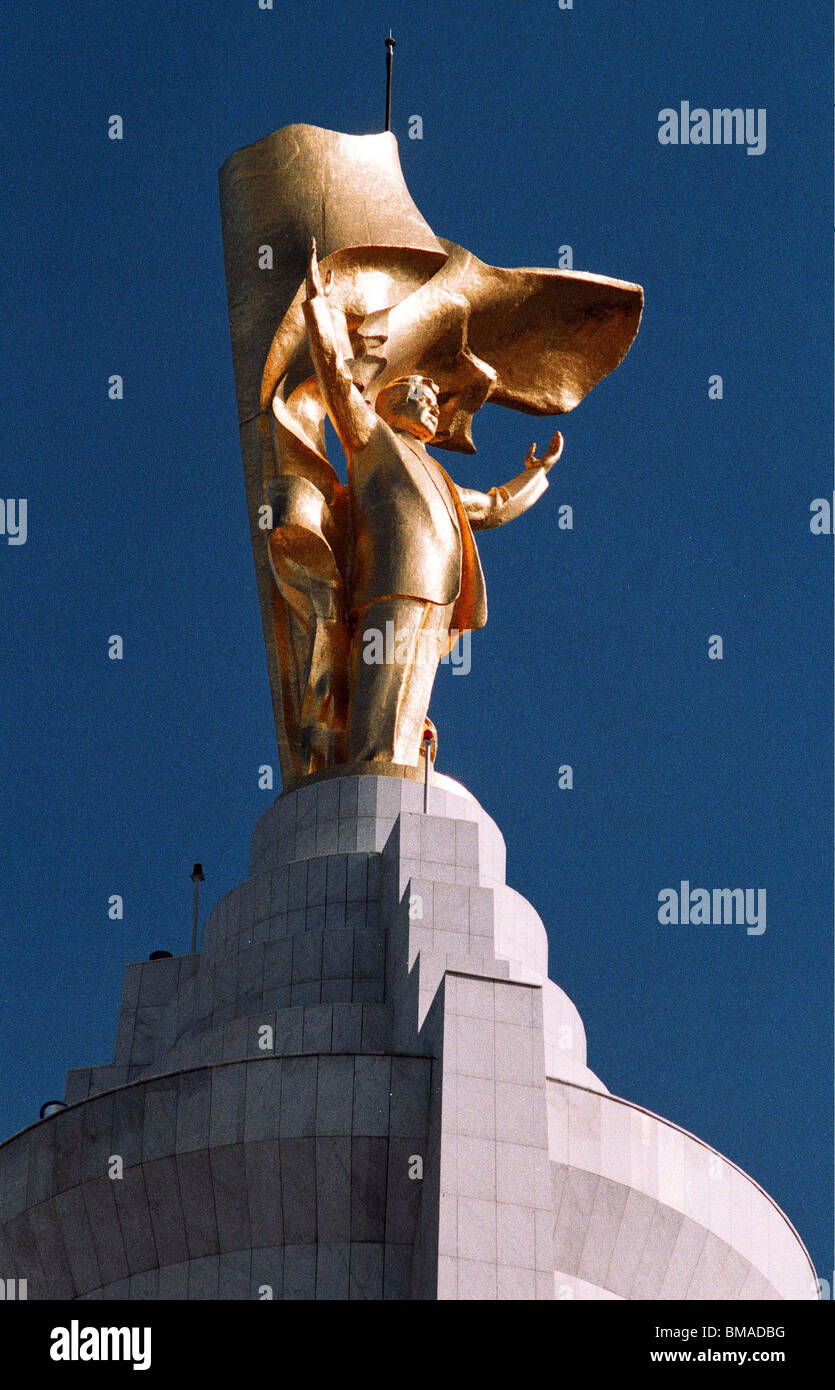 A gold-plated statue of Turkmenistan President Saparmurat Niyazov stands atop a 120 metre tower - Stock Image