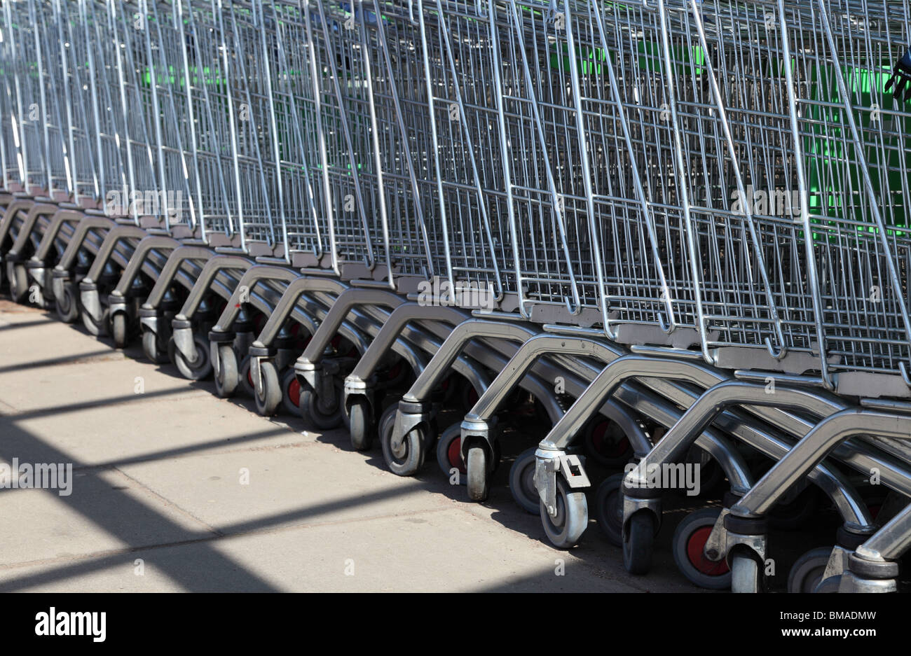 Stacked shopping trolleys - Stock Image