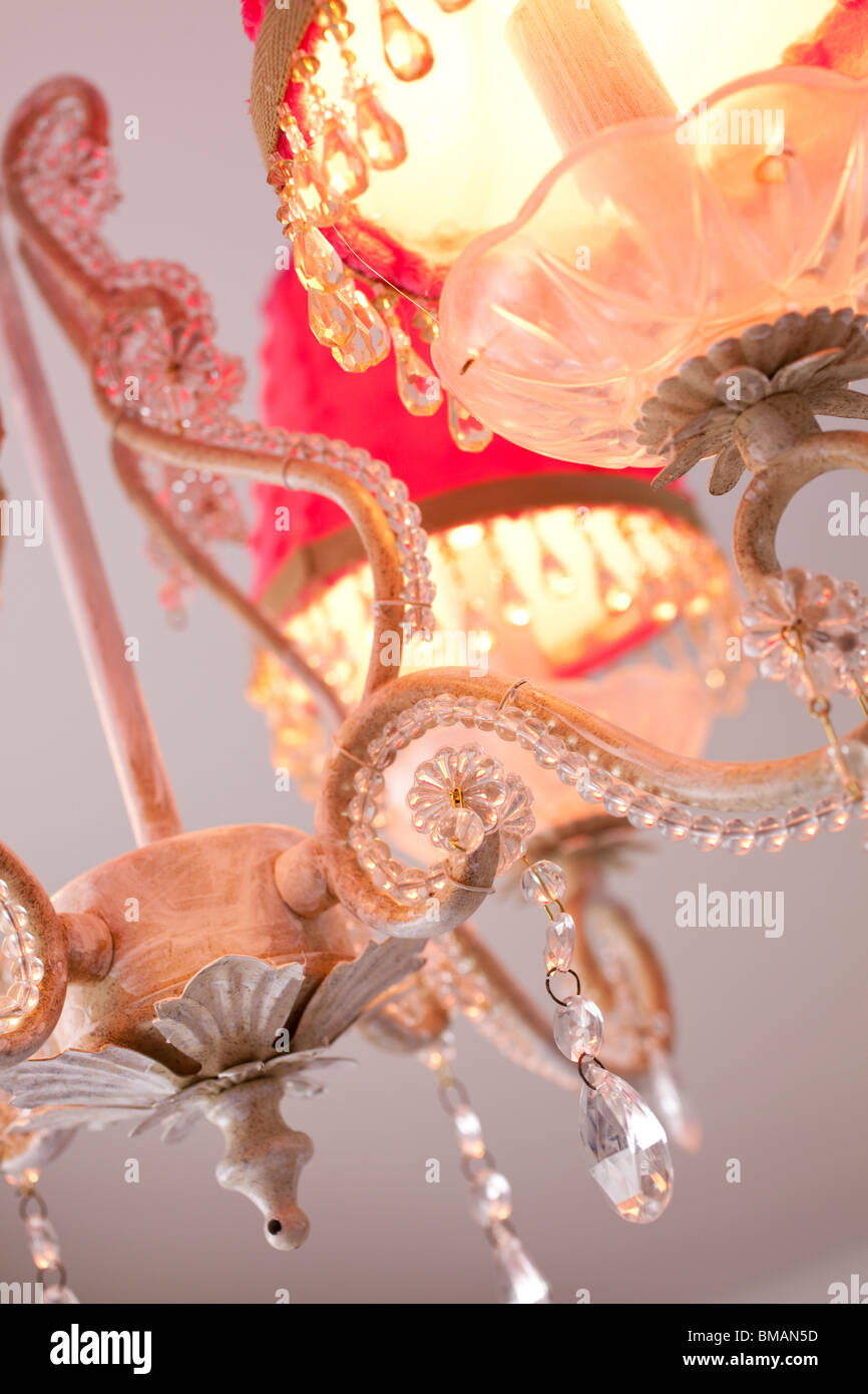 Pretty chandelier decorated with crystal beads and pink shades for a girl teenager room