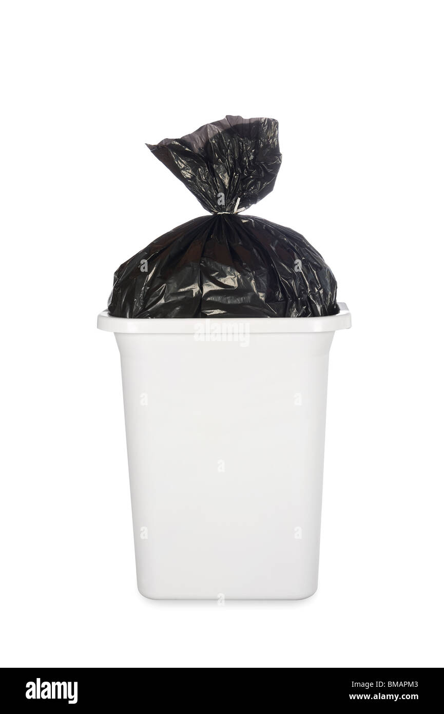A white trash can with a black trash bag full of garbage. - Stock Image