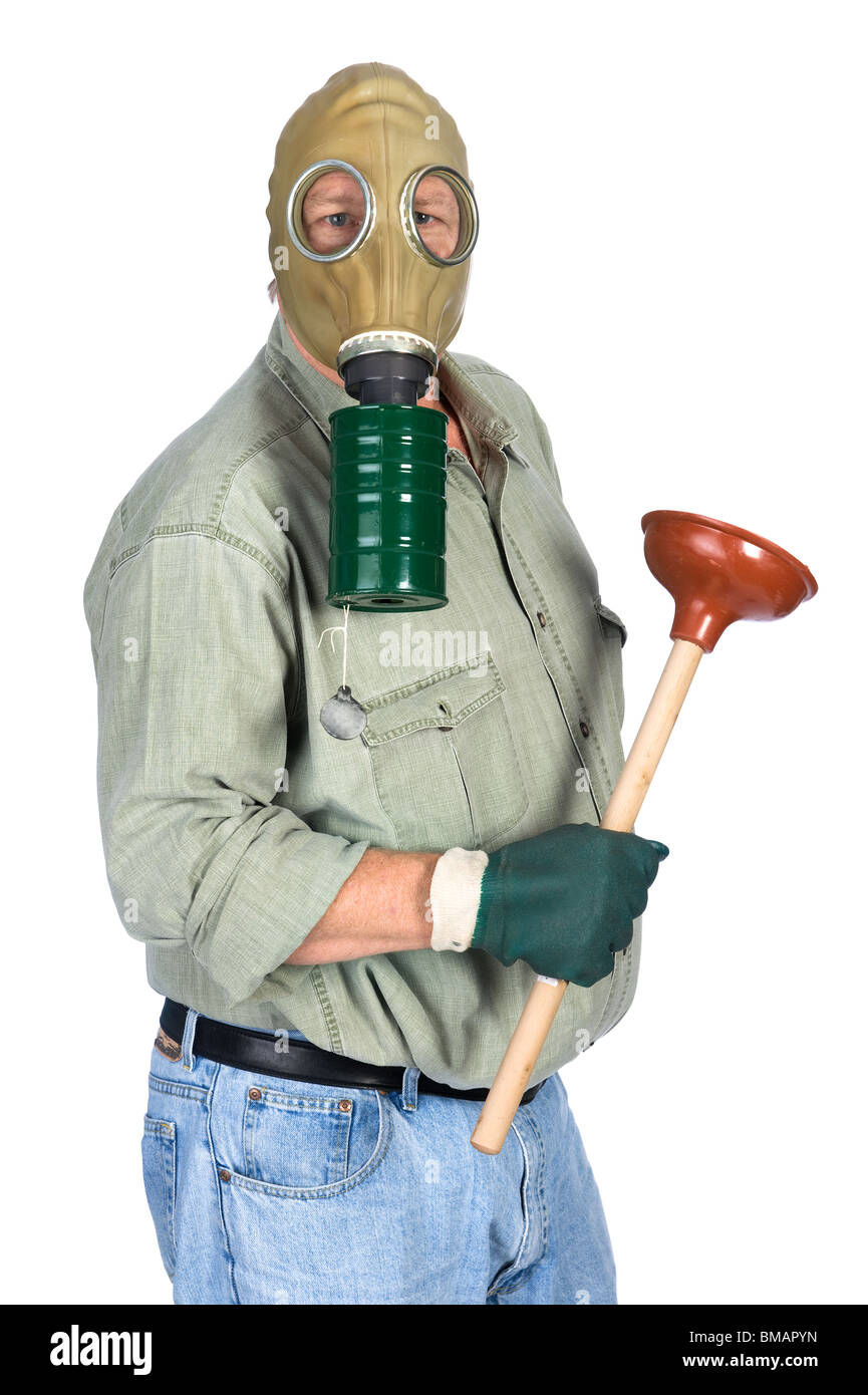 A plumber wears his gas mask as he prepares to unplug a toilet. - Stock Image