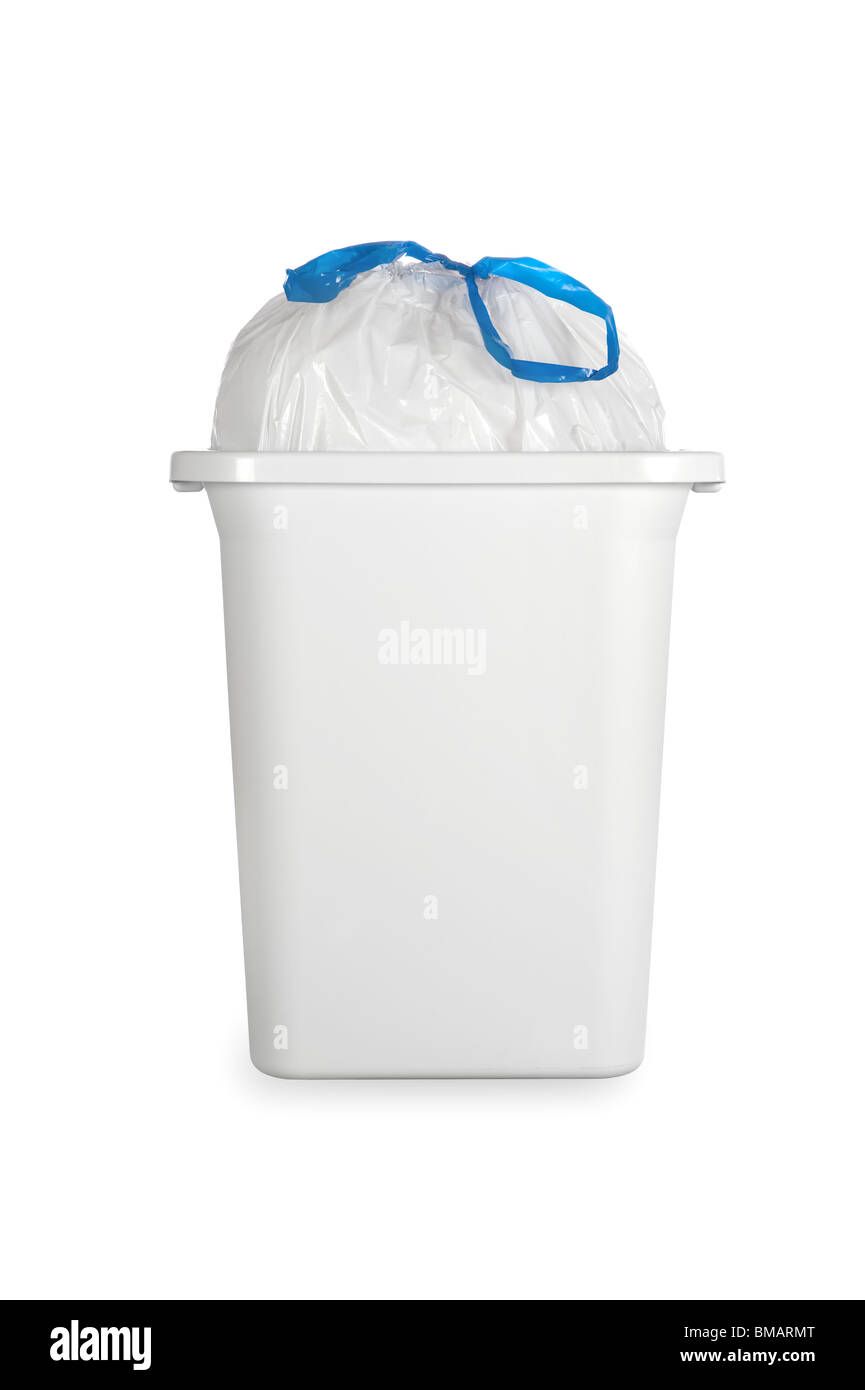 A white trash can with a full plastic garbage bag tied with a blue draw band. - Stock Image