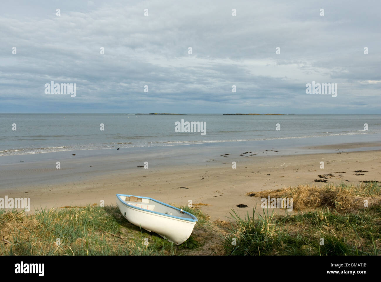 Rowing boat on the beach at Low Newton by the Sea, Northumberland, England. - Stock Image