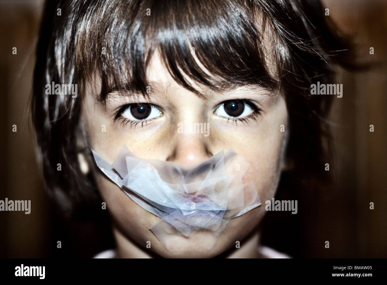 young boy gagged with tape - Stock Image