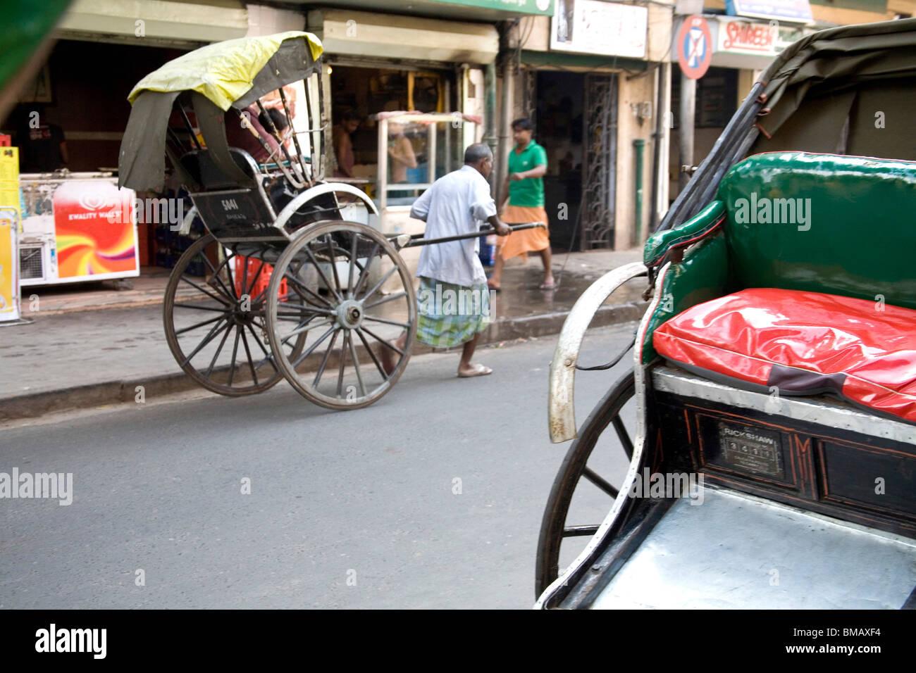 Manual labor ; man pulling empty vehicle ; Calcutta now Kolkata ; West Bengal ; India - Stock Image