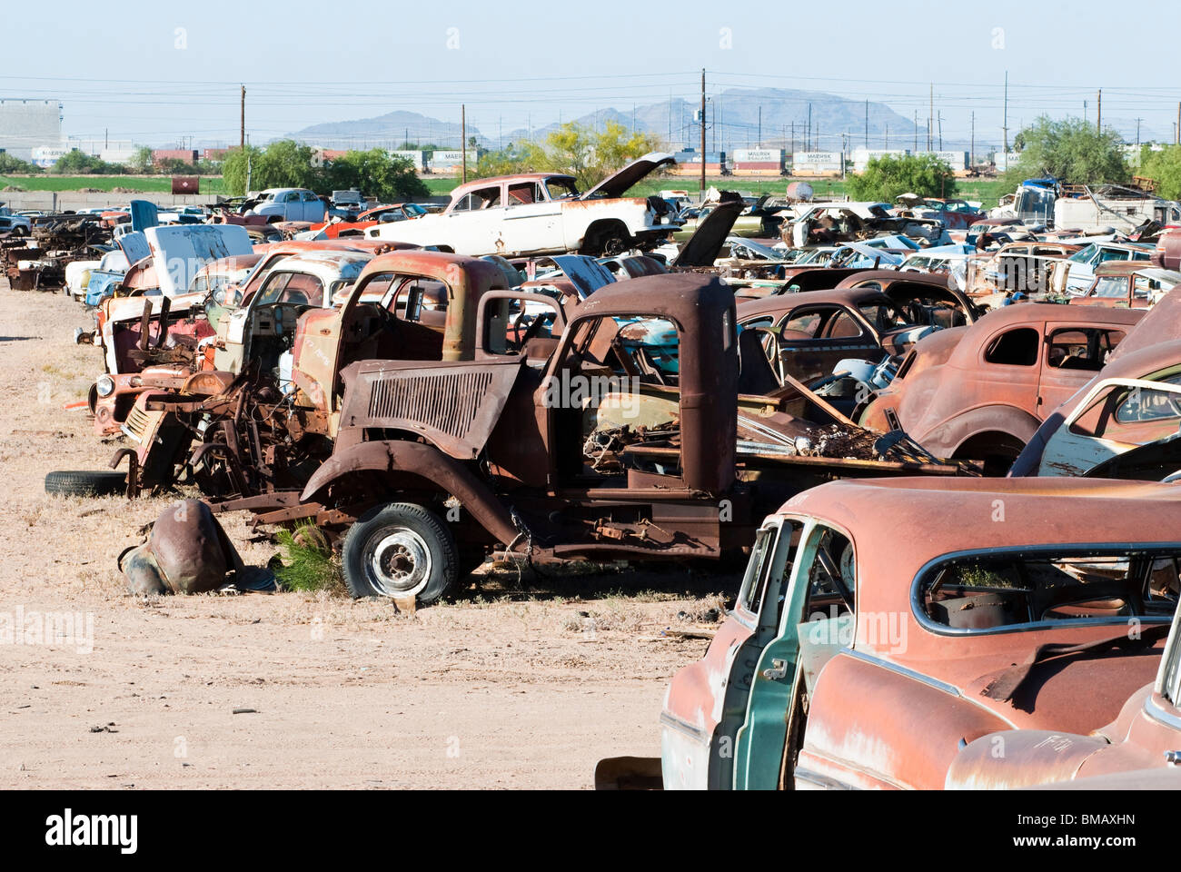 old vehicles in an auto salvage yard being recycled for parts and ...