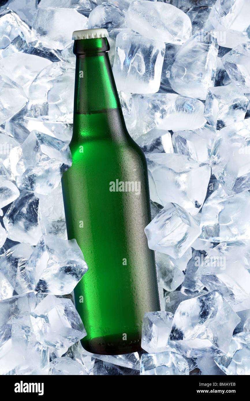 Bottle of beer on ice - Stock Image