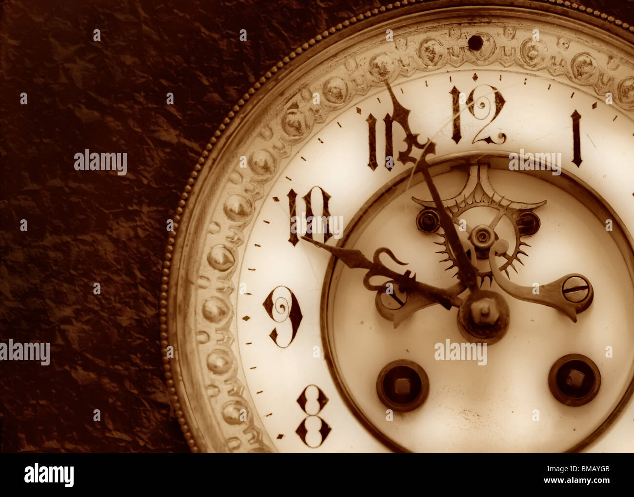 Old clock on the relief background - Stock Image