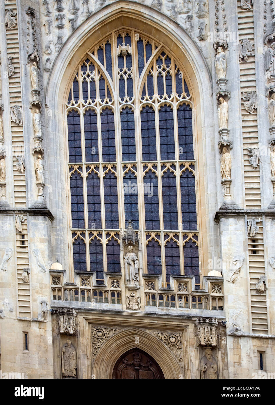 Bath Abbey frontage with ascending and descending angels - Stock Image