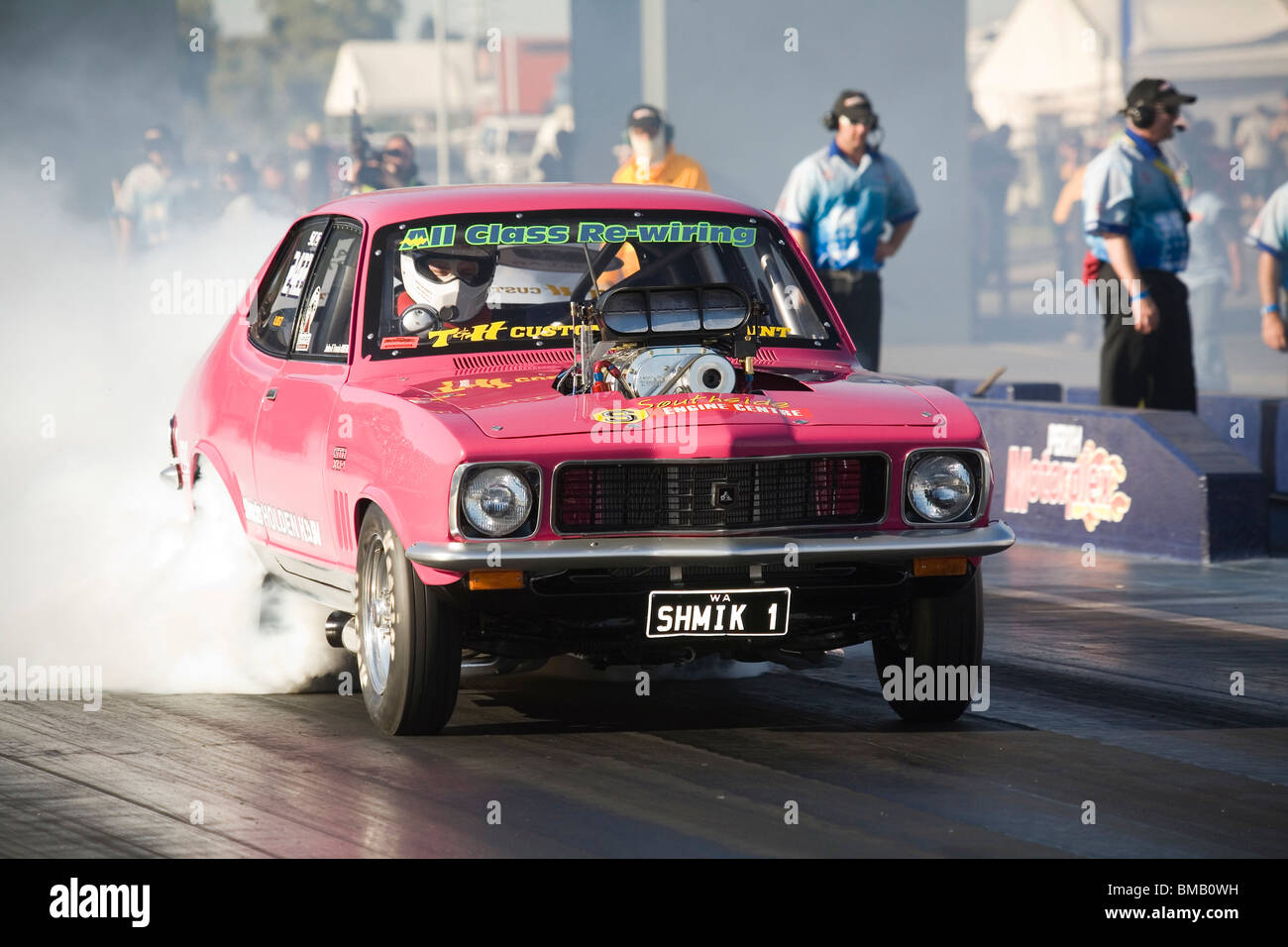 Supercharged Holden Torana drag racing car performing a burnout prior to racing at the Perth Motorplex, Western Stock Photo