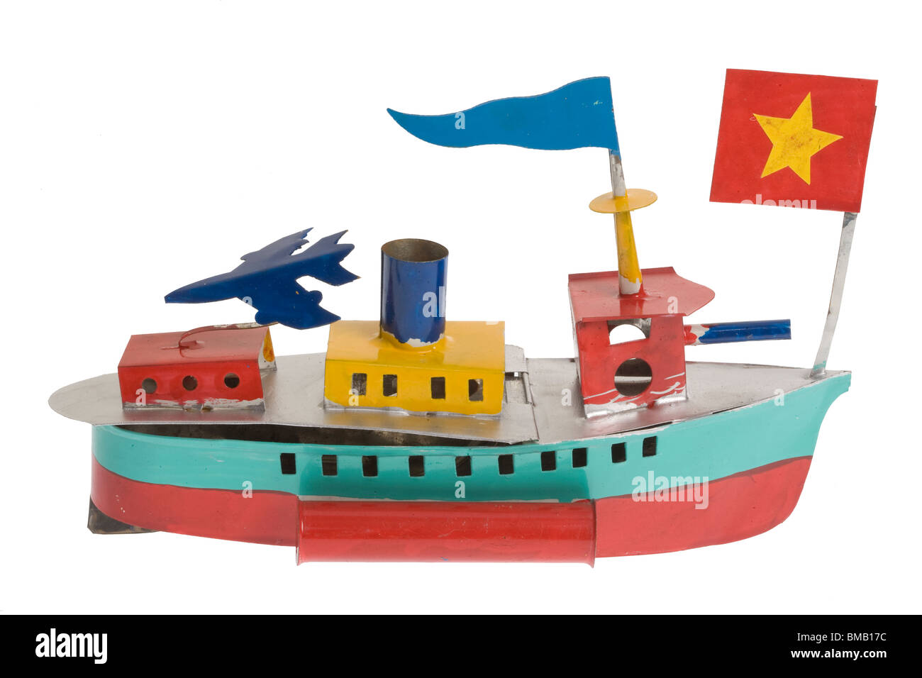 recycled scrap metal tin toy boat - Stock Image