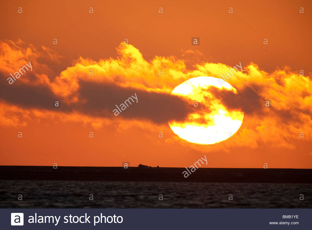 The sun rises in a blaze of color over the Beaufort Sea off the coast of ANWR - Stock Image