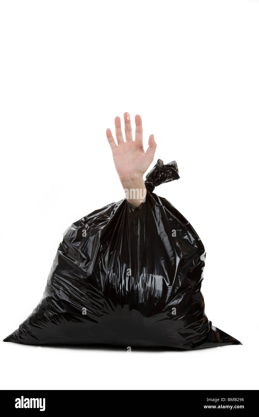 Black Garbage Bag and hand, concept of Loser - Stock Image