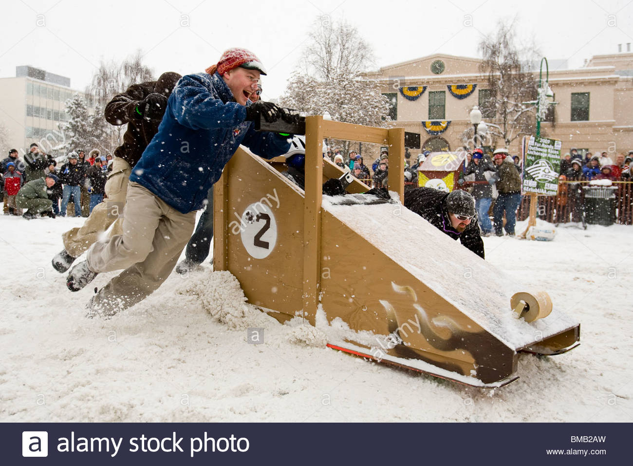 Alaska, Anchorage. Fur Rondezvous winter carnival. Outhouse races. - Stock Image