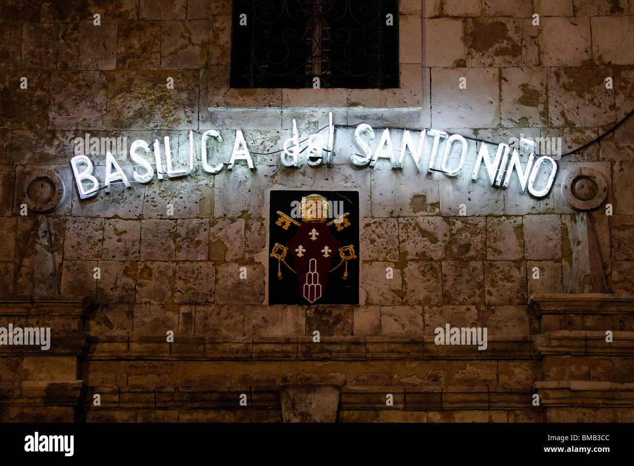 Neon lights on wall of Basilica of Santo Niño - Stock Image