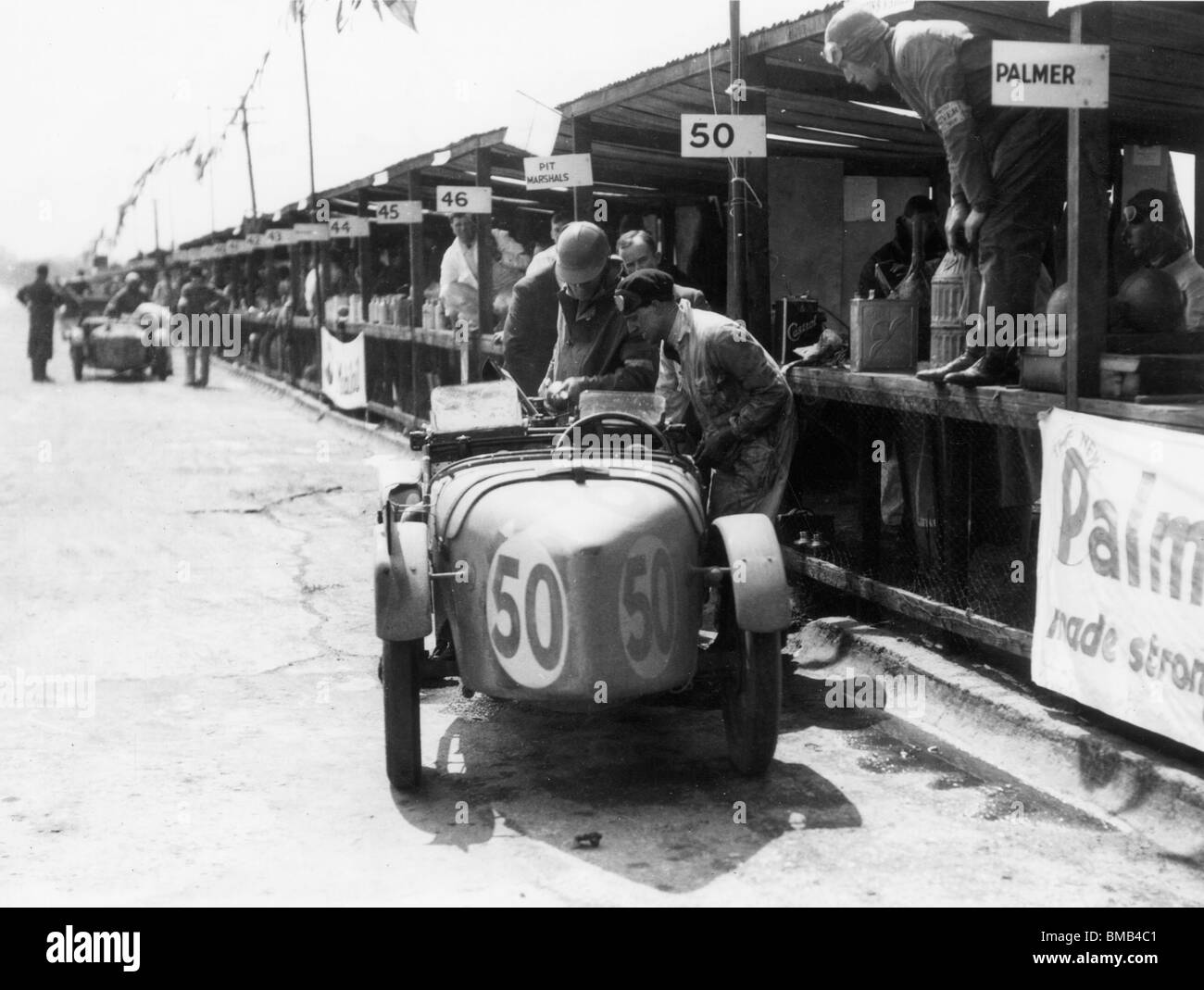 Austin 7 Ulster works in the pits at Brooklands 1930 - Stock Image