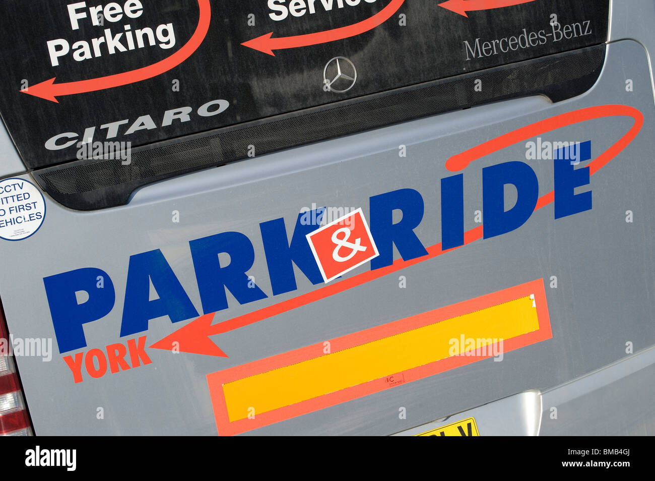 Graphics and text on the back of a park and ride bus - Stock Image