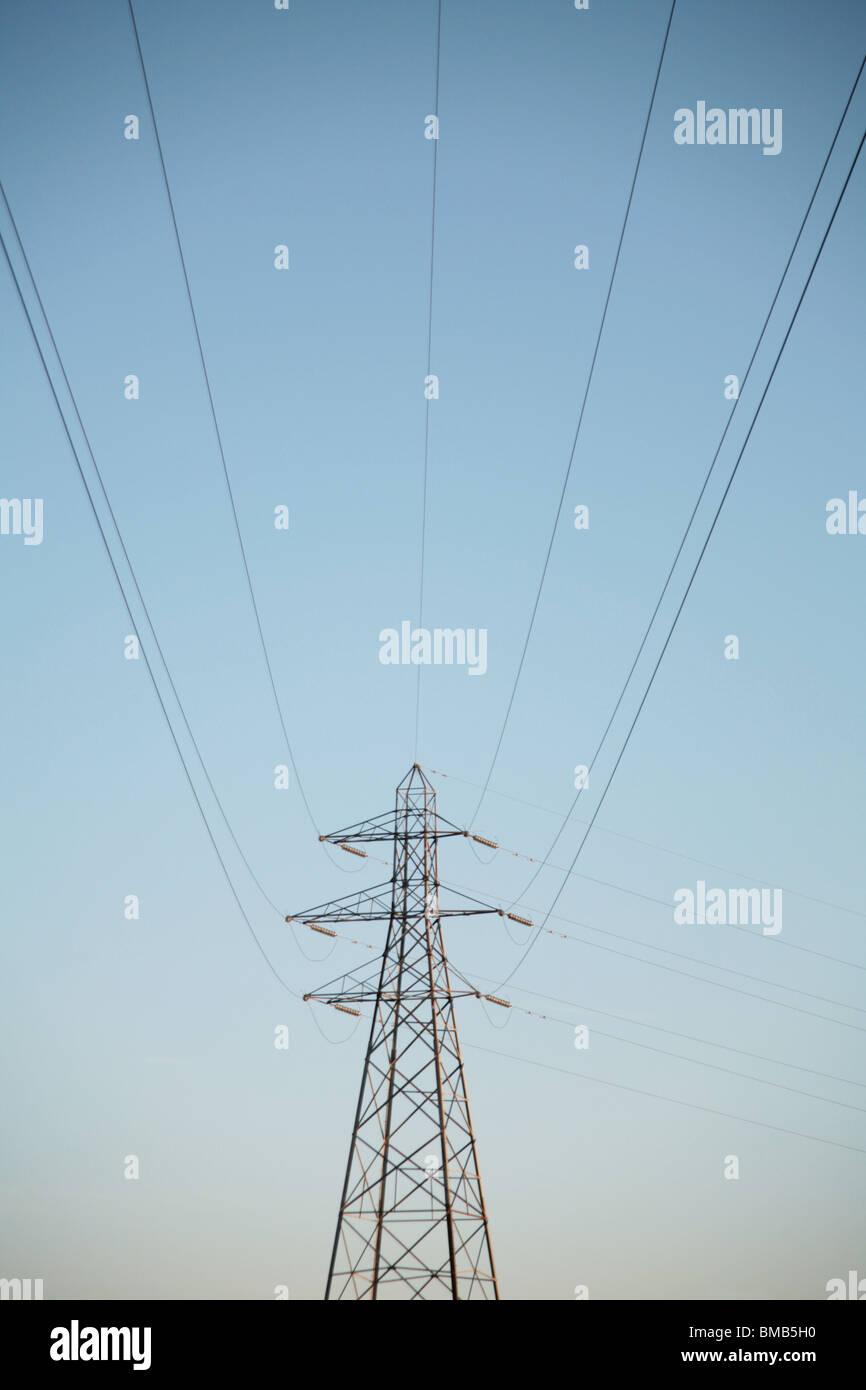 Powerlines and Pylon against a blue sky, eastlothian, scotland 2010 - Stock Image
