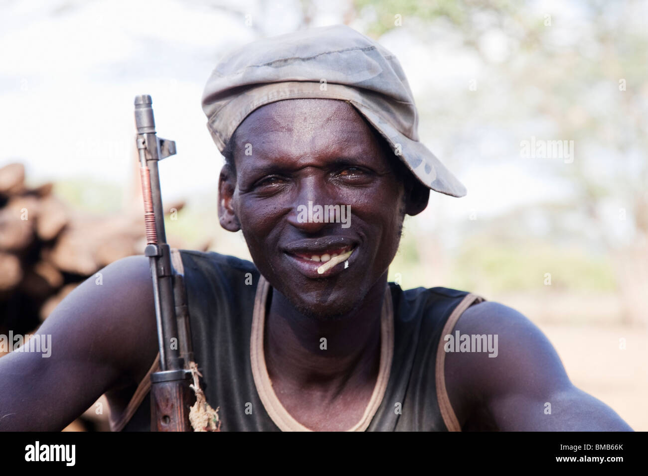 Tsemai tribal from  Southern Ethiopia with a gun - Stock Image