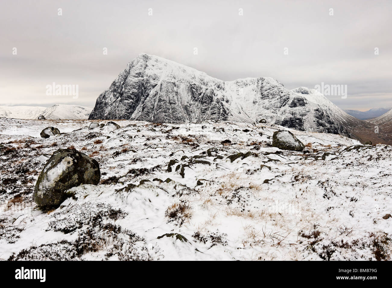High on Scottish mountains, in hard winter conditions. This is a view of Buachaille Etive Mor from Beinn a Chrulaiste. - Stock Image