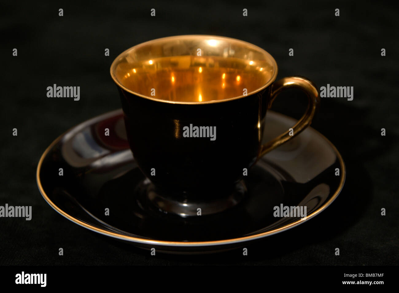 Noritake Gold and Black coffee cups and saucers - Stock Image