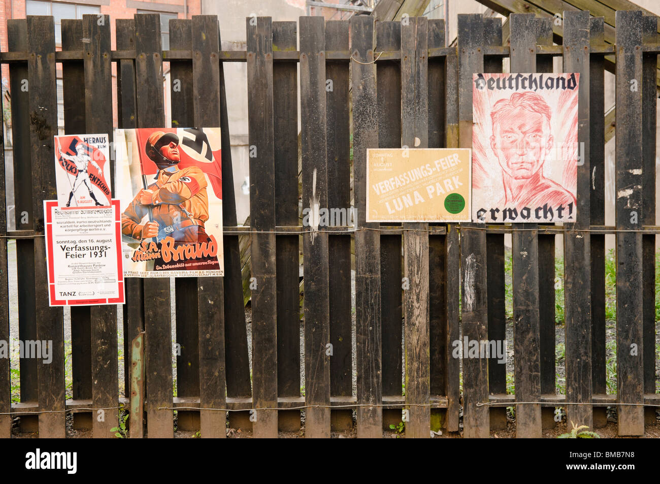 Nazi Propaganda posters on a fence on a film set recreating Berlin in the mid 1930s - Stock Image