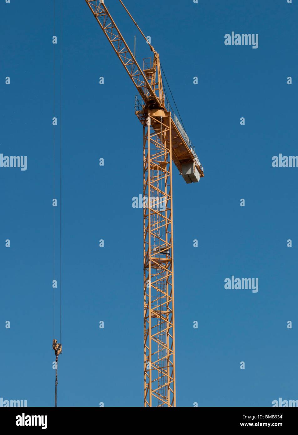 Blue sky crane, construction is under progress Stock Photo