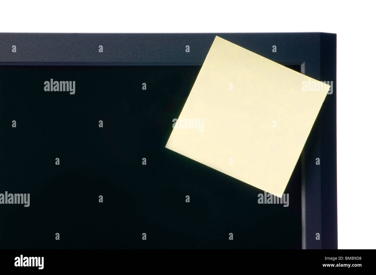 comupter monitor with post it note sticky note - Stock Image