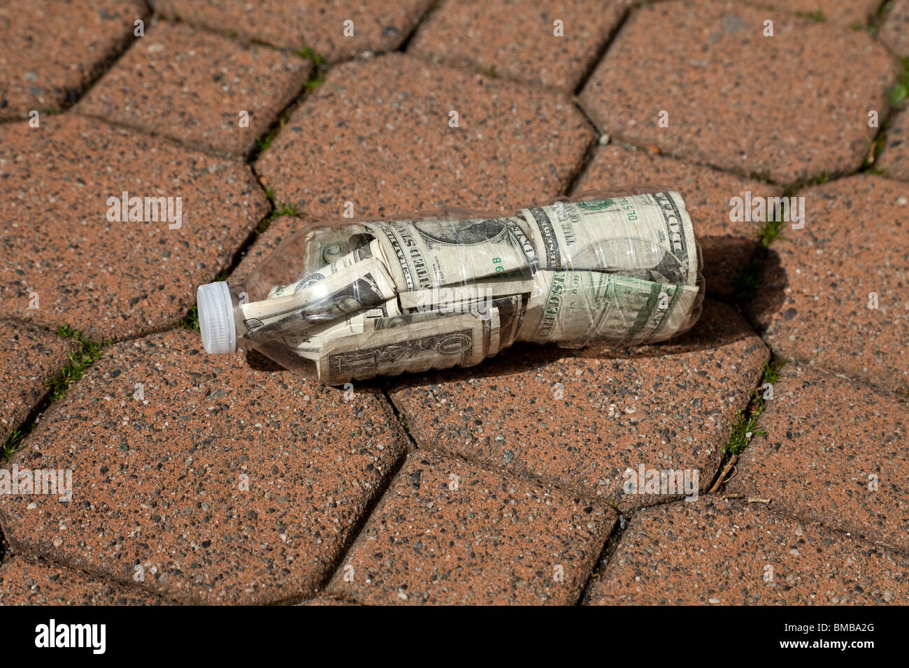Plastic Bottle and Dollar close up - Stock Image