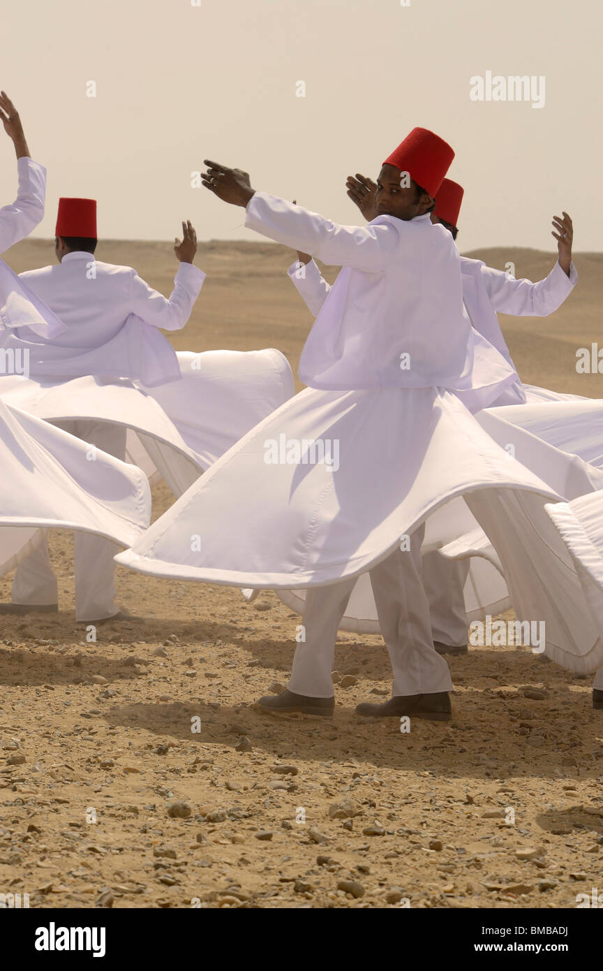 Whirling Dervishes performing at the pyramids of giza, Necropolis bordering what is now El Giza, cairo , egypt - Stock Image