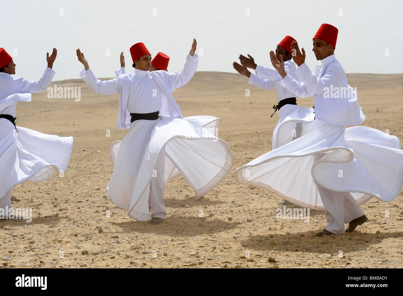 Whirling Dervishes performing at the pyramids of giza,Giza Necropolis bordering what is now El Giza, cairo , egypt - Stock Image