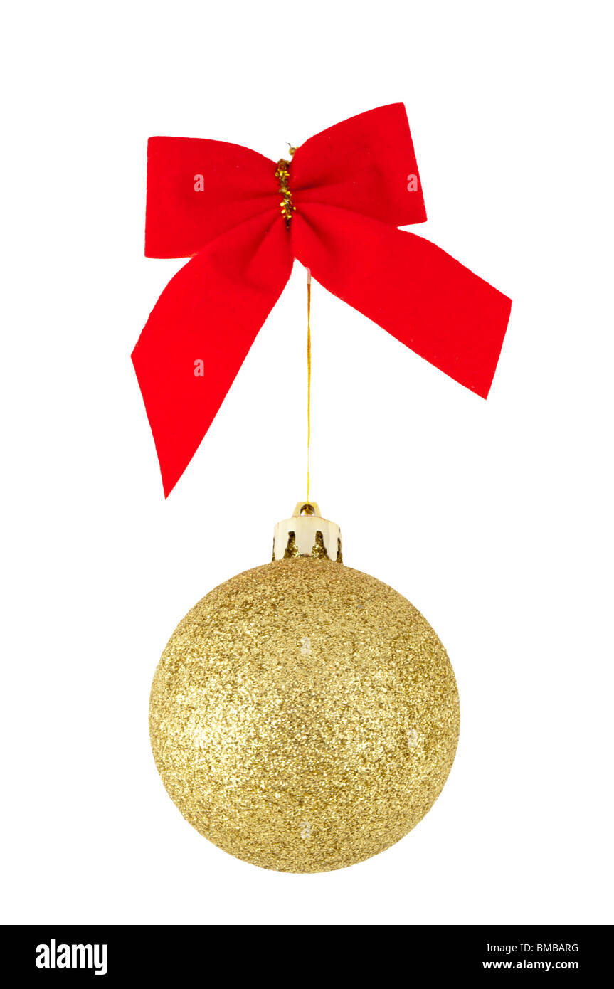 Red bow and golden christams ball, isolated on white - Stock Image