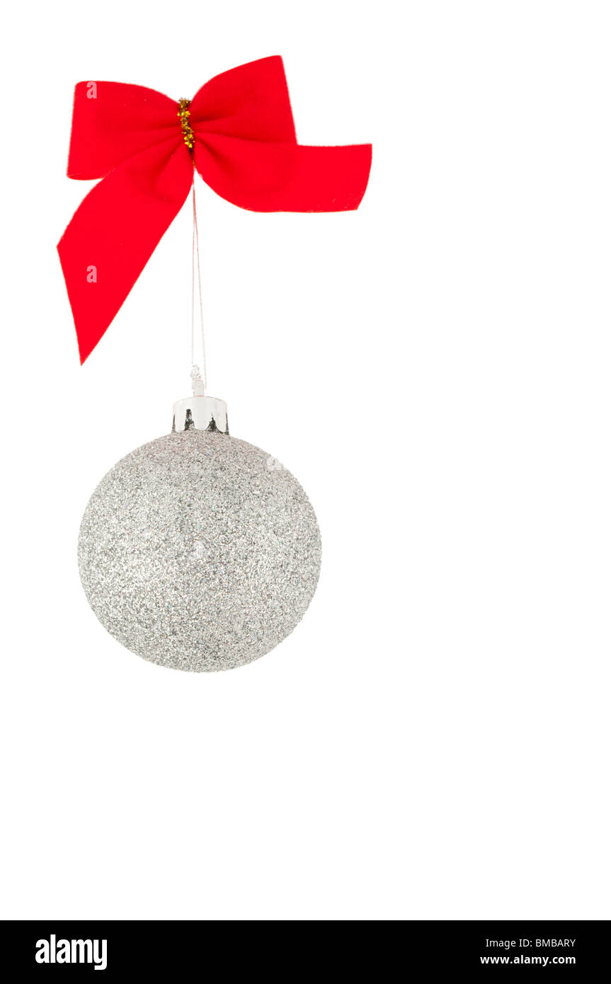 Red bow and silver christmas ball, isolated on white - Stock Image