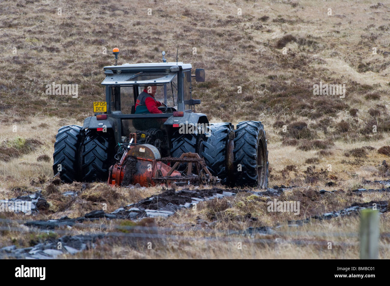 Peat extracting tractor on the Isle of North Uist. - Stock Image