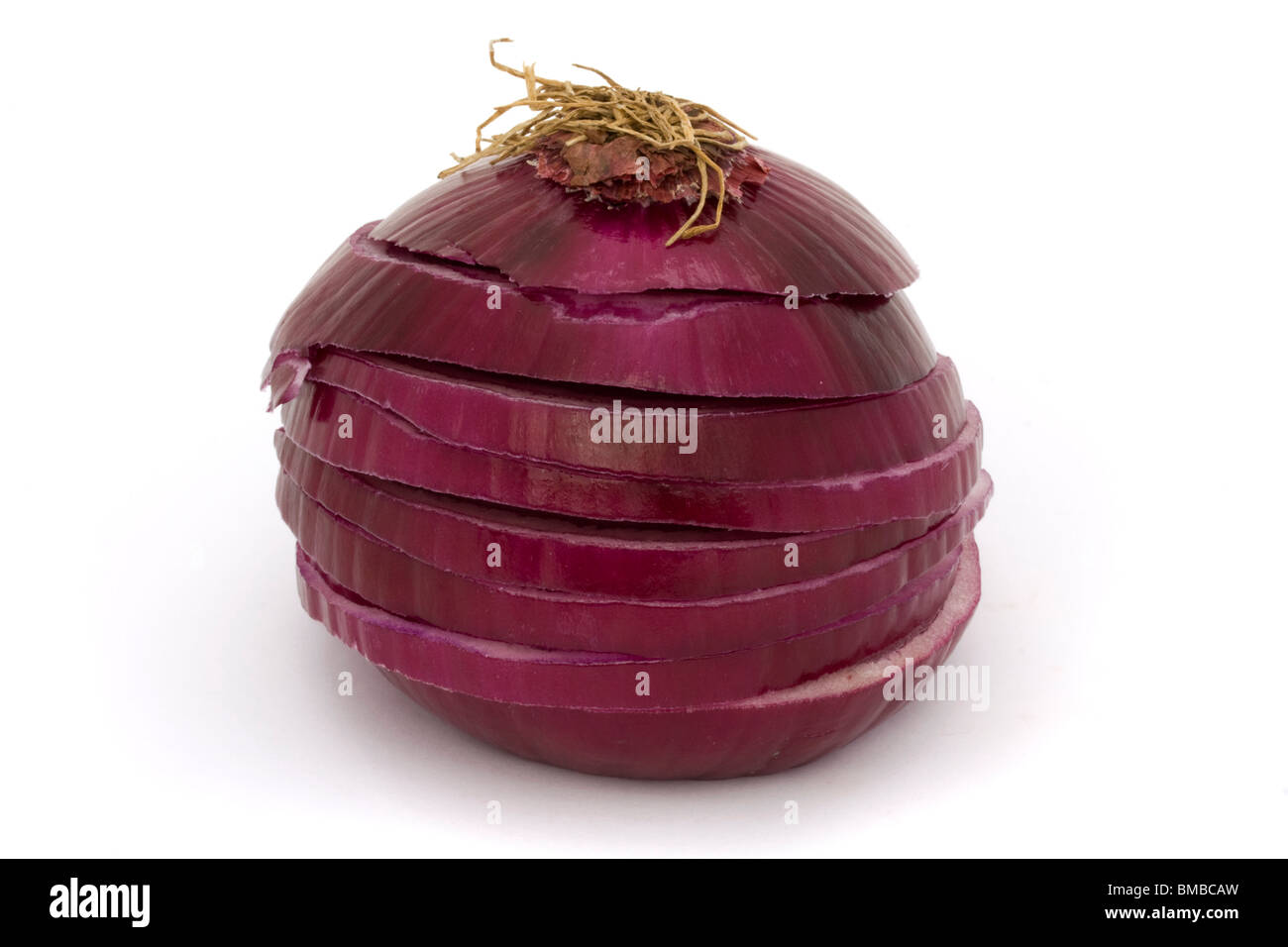 sliced red onion on a white background - Stock Image