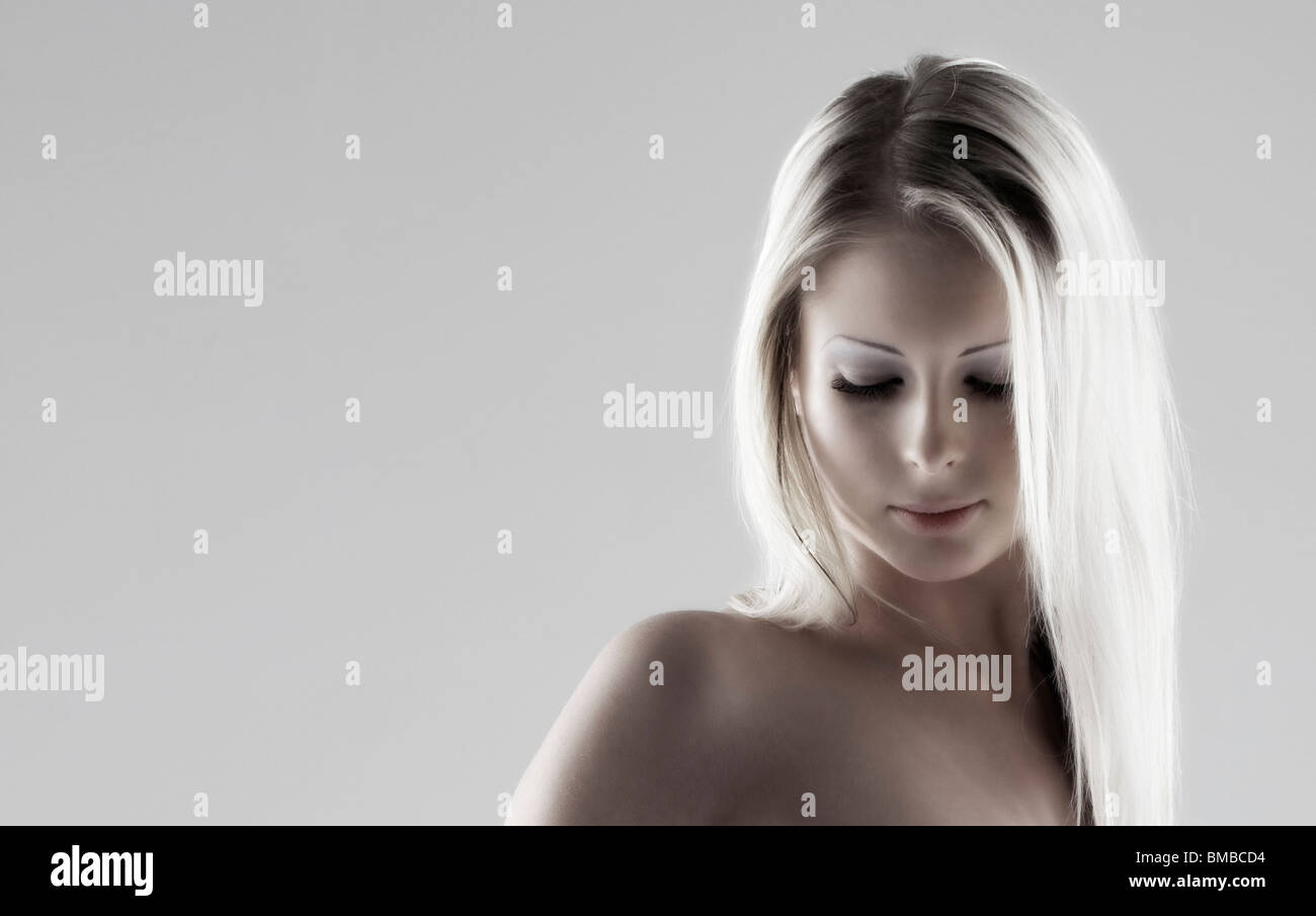 girl,face,cosmetic,beauty,face,expression,sad,thinking,pensive,eyes,mouth,fashion,changeling - Stock Image