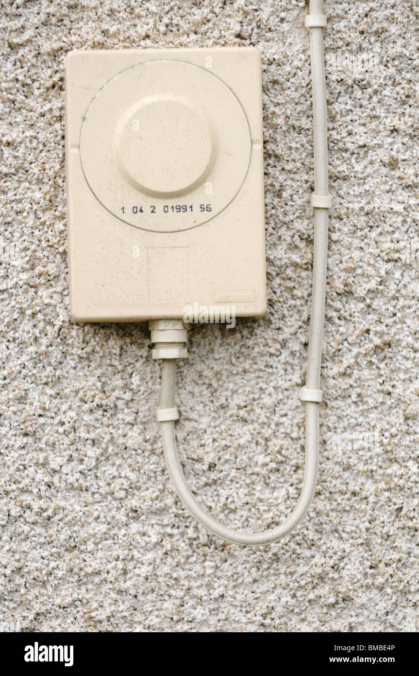 Stock photo of a French electricity reader on an exterior wall. - Stock Image