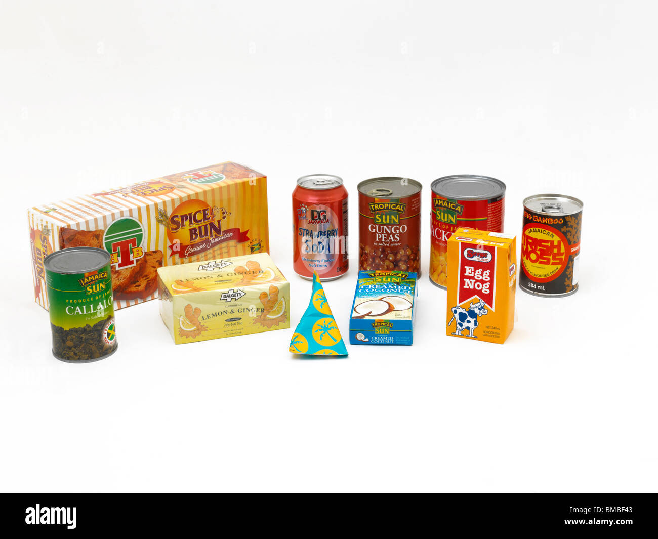 Selection Of Packets Of Caribbean Food In Shapes Of Prisms, Triangular, Cylindrical And Cuboid - Stock Image