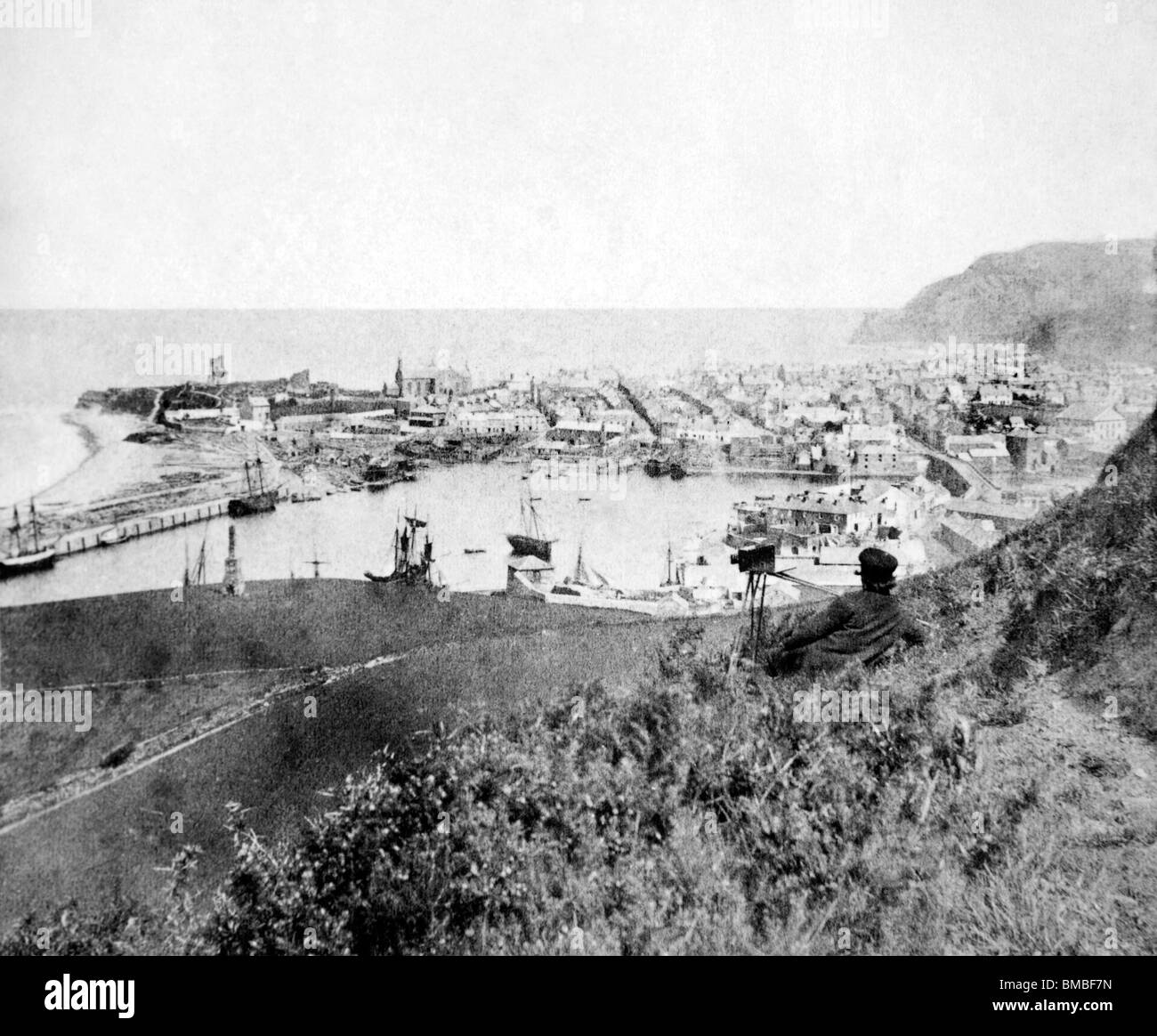 Wales, Victorian photographer with camera photographing Aberystwyth Harbour in mid 1800s - Stock Image