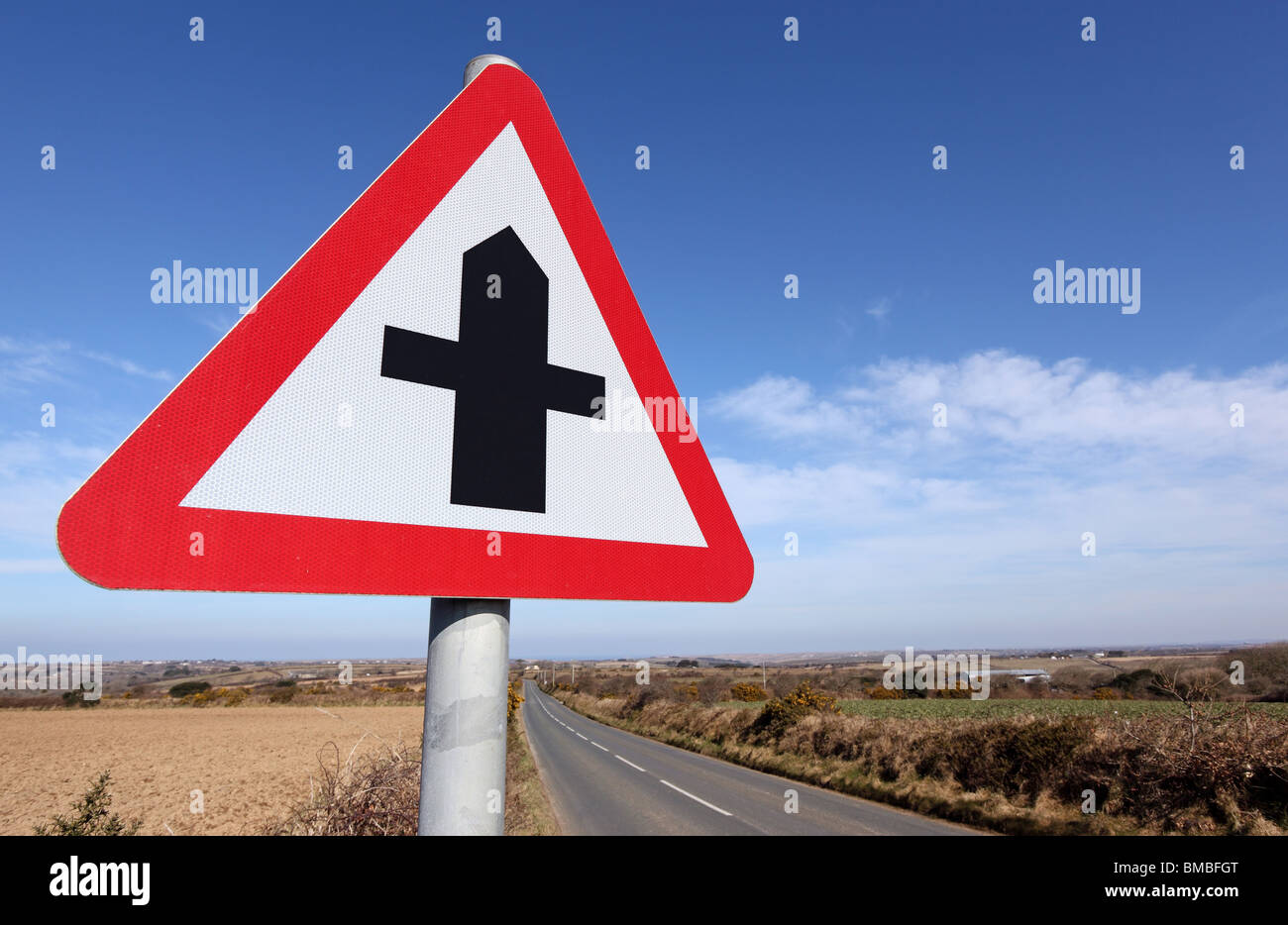 British crossroads ahead road sign warning. - Stock Image