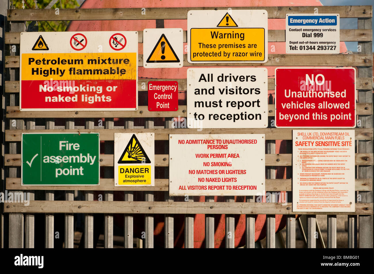 Many hazard dangerous risk signs on an oil depot entrance, UK - Stock Image
