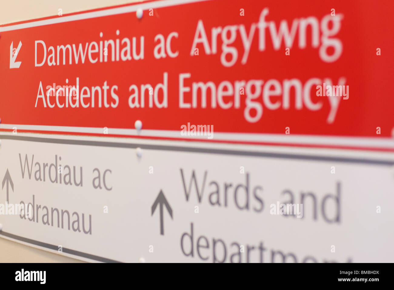 A sign for accidents and emergency in Aberystwyth Bronglais hospital, shot with a shallow depth of field. - Stock Image