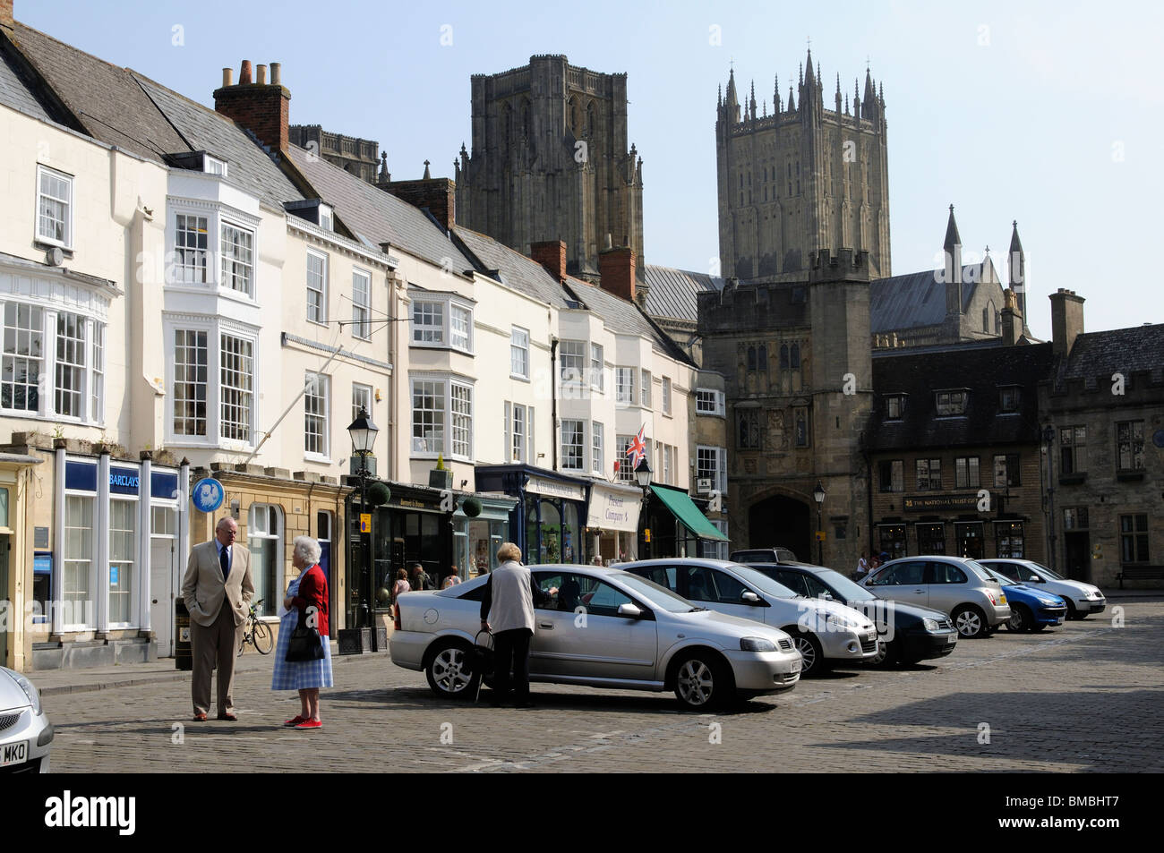 Market Street shops and Wells Cathedral in Wells town centre Somerset England UK - Stock Image