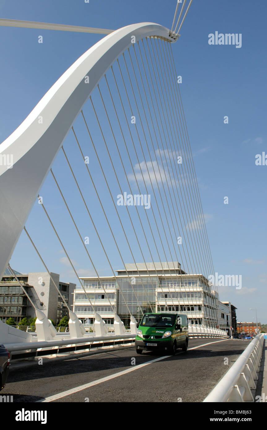 Samuel Beckett Bridge Docklands Dublin Ireland A green post office vehicle passing over - Stock Image