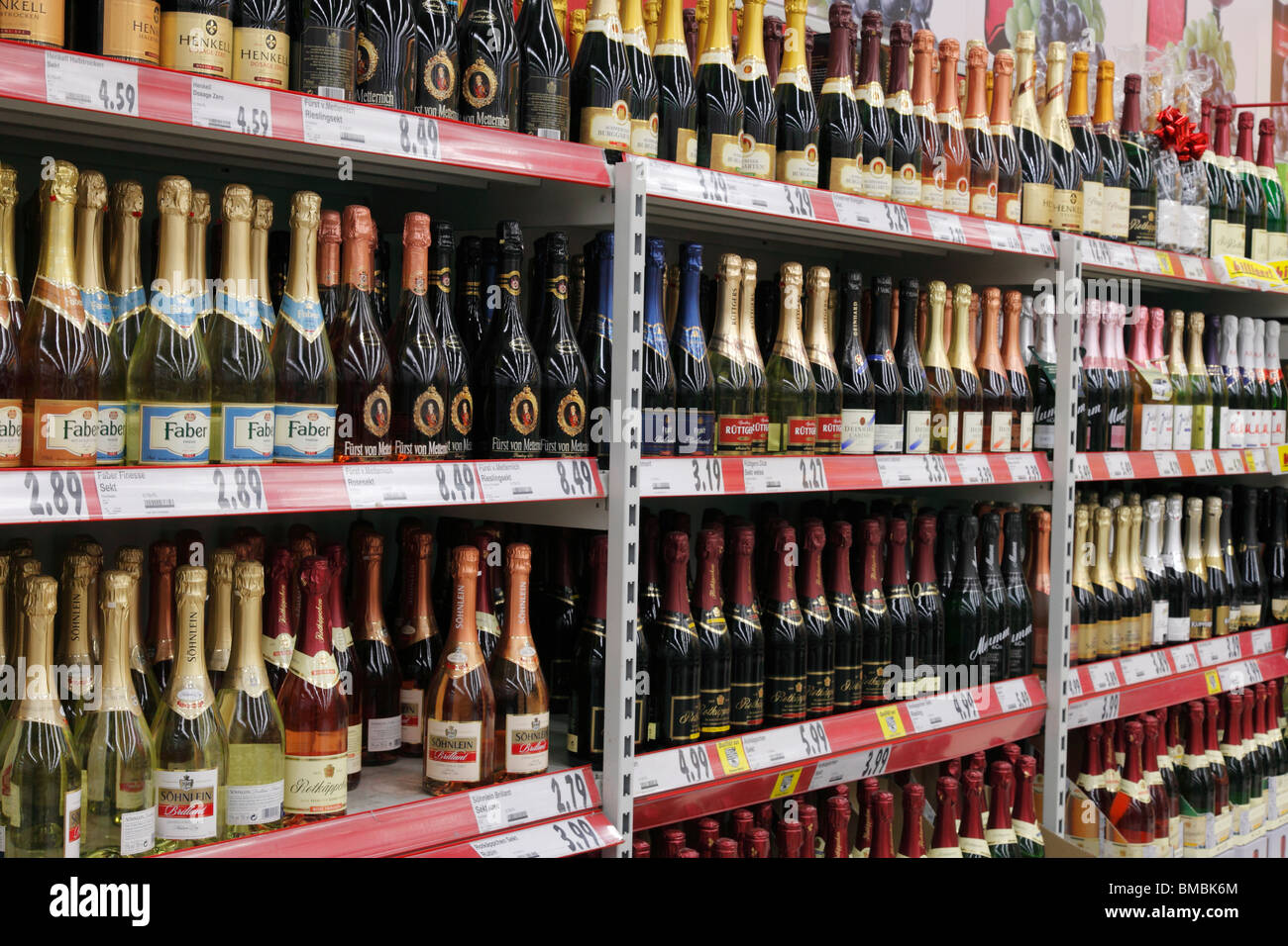 champagne and sparkling wine shelf in a supermarket - Stock Image