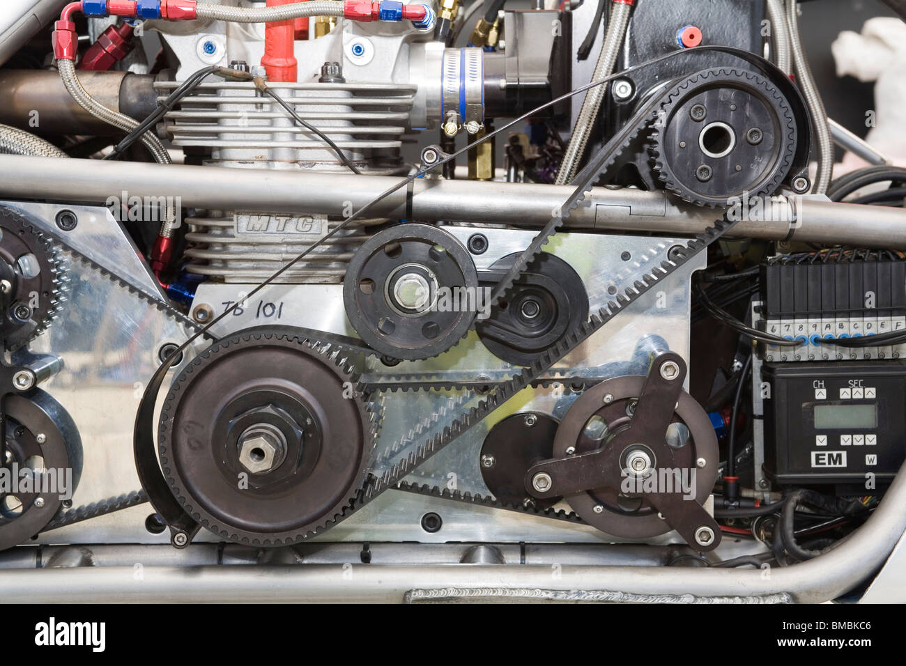 Belts and cog / cogs wheel / wheels on the side of a custom supercharged drag racing motorcycle engine - Stock Image