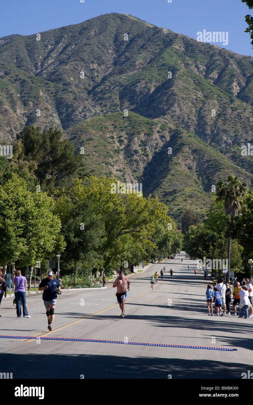 Runners Coming Back out of the Mountains and Heading for the Finish Line - Stock Image